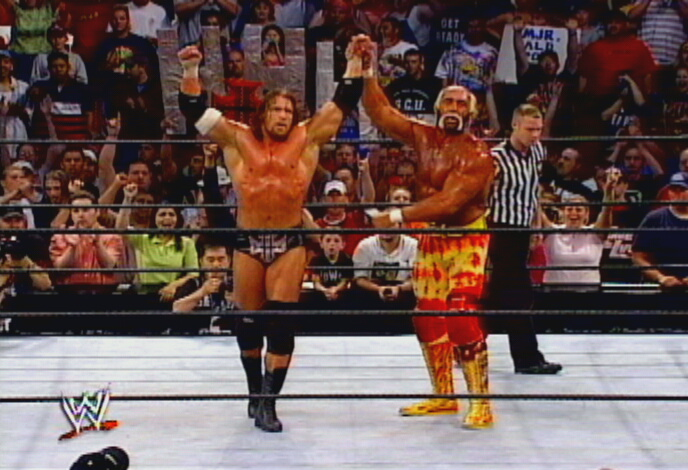 Hogan Holds Up Triple H's Arm