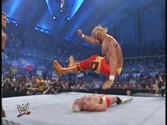 Hogan Goes For The Leg Drop On Billy