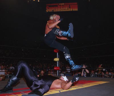 Hogan Goes For The Leg Drop On Sting